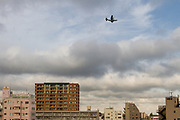 A Lockheed C130 Hercules transport aircraft of the Japanese Air Self Defense Force flies low over Chou Rinkan in Kanagawa. Tuesday May 31st 2016