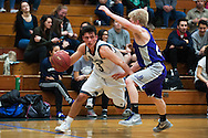 Burlington's Kuitim (3) drives to the hoop past Brattleboro's Dylan DeJordy (25) during the boys basketball game between Brattleboro and Burlington at Burlington High School on Saturday afternoon December 19, 2015 in Burlington. (BRIAN JENKINS/for the FREE PRESS)