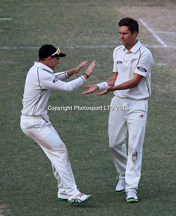 Pakistan vs New Zealand, 19 November 2014 <br /> Trent Boult celebrates with team mates after taking the wicket of Misbah Ul Haq on the third day of second test in Dubai