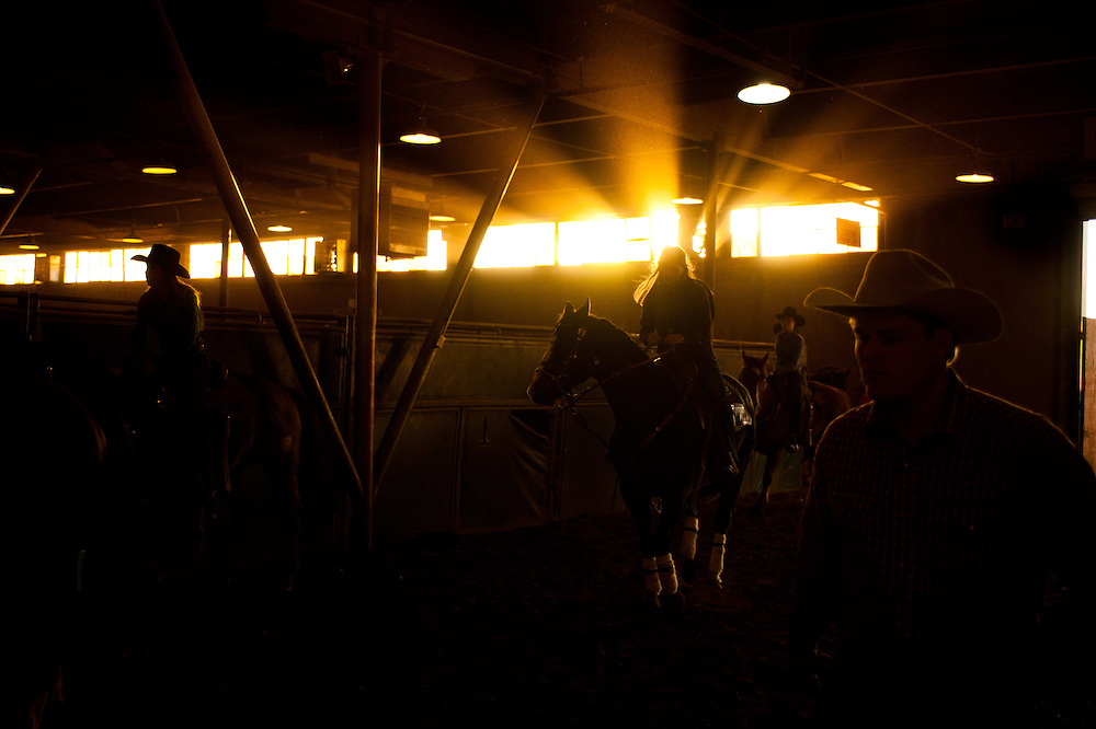 Warmups in the barn during a rodeo performance at the Denver Coliseum.