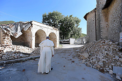 October 4, 2016 - Amatrice, Italy - POPE FRANCIS walks next to rubble in the quake-struck village of San Pellegrino. Pope Francis made an unexpected trip to the region. (Credit Image: © Osservatore Romano/Eidon Press via ZUMA Press)