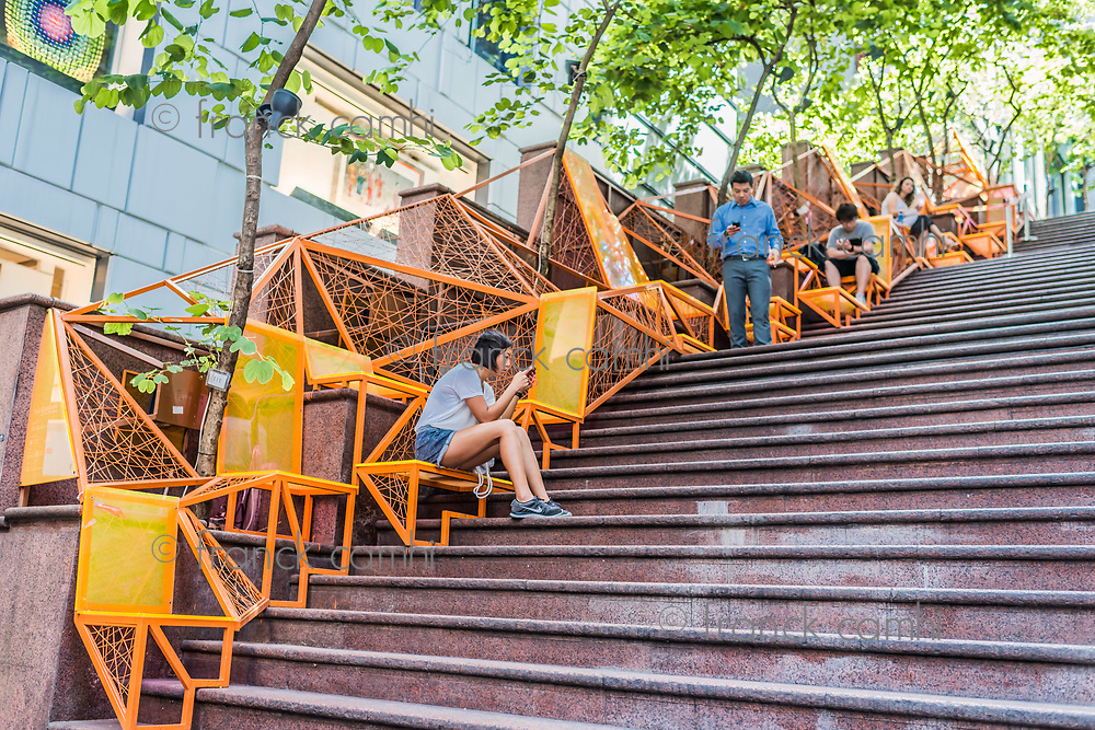 Central, Hong Kong, China- June 4, 2014: people using smartphones in street stairs at Soho