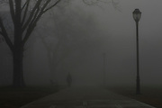 A woman walks down the sidewalk of Myers Quad during a foggy morning in Athens, Georgia, on Saturday, Sept. 12, 2016. (Photo/Casey Sykes, www.caseysykes.com)
