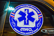 "30 NOVEMBER 2012 - BANGKOK, THAILAND: A sticker on an Ruamkatanyu Foundation ambulance. The Ruamkatanyu Foundation was started more than 60 years ago as a charitable organisation that collected the dead and transported them to the nearest facility. Crews sometimes found that the person they had been called to collect wasn't dead, and they were called upon to provide emergency medical care. That's how the foundation medical and rescue service was started. The foundation has 7,000 volunteers nationwide and along with the larger Poh Teck Tung Foundation, is one of the two largest rescue services in the country. The volunteer crews were once dubbed Bangkok's ""Body Snatchers"" but they do much more than that now.    PHOTO BY JACK KURTZ"
