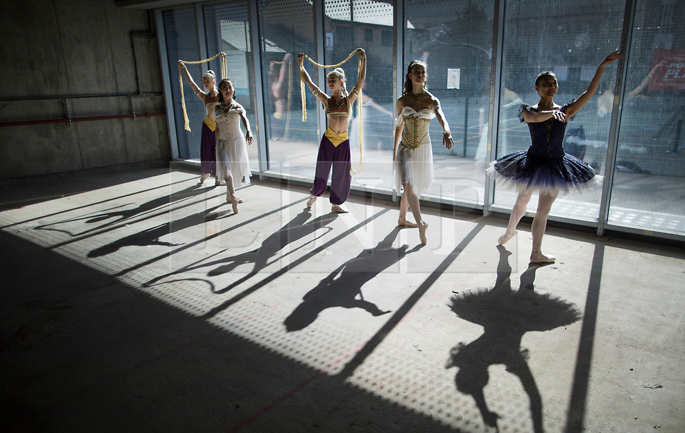 © Licensed to London News Pictures. 21/03/2017. London, UK. Performers pose in The Central School of Ballet's newly announced building in central London. The dancers wear costumes from their forthcoming nationwide Ballet Central tour 2017 against the backdrop of the unfinished interior of the new premises. Photo credit: Peter Macdiarmid/LNP