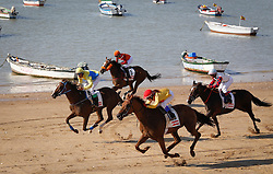 Traditional Horse Racing at Cadiz beaches in Cadiz, Spain, <br /> Sunday 18th August 2013. Picture by Esteban Perez Abion / Sevilla Press / DyD Fotografos / i-Images. <br /> SPAIN OUT