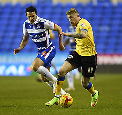 Wigan Athletic's James McClean wins the ball away from Reading's Stephen Kelly - Photo mandatory by-line: Paul Knight/JMP - Mobile: 07966 386802 - 17/02/2015 - SPORT - Football - Reading - Madejski Stadium - Reading v Wigan Athletic - Sky Bet Championship