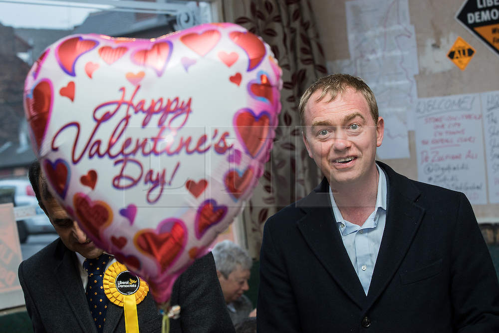 © Licensed to London News Pictures . 14/02/2017 . Stoke-on-Trent , UK . Lib Dem leader TIM FARRON (r) with candidate DR ZULFIQAR ALI (behind a Happy Valentine's Day balloon) at the Liberal Democrat by-election base in the Wheatsheaf Pub on Sheaf Street , campaigning in the Stoke Central by-election . Photo credit : Joel Goodman/LNP