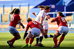 Sarah Beckett of England Women is tackled by Bethan Lewis of Wales Women and Siwan Lillicrap of Wales Women - Mandatory by-line: Ryan Hiscott/JMP - 24/02/2019 - RUGBY - Cardiff Arms Park - Cardiff, Wales - Wales Women v England Women - Women's Six Nations