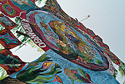 The kites are constructed with intricate designs of colored tissue paper anchored on a bamboo web.