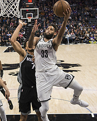 March 1, 2018 - Sacramento, CA, USA - The Brooklyn Nets' Allen Crabbe (33) drives agaainst the Sacramento Kings' Skal Labissiere (7) in the first quarter at the Golden 1 Center in Sacramento, Calif., on Thursday, March 1, 2018. (Credit Image: © Hector Amezcua/TNS via ZUMA Wire)