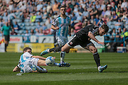Mark Hudson (C) (Huddersfield Town) gets a crucial tackle in during the Sky Bet Championship match between Huddersfield Town and Brentford at the John Smiths Stadium, Huddersfield, England on 7 May 2016. Photo by Mark P Doherty.