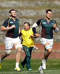 South Africa's Pierre Spies, right, runs with teammate Danie Rossouw during a training session at the Rugby League Park in Wellington, New Zealand, Tuesday, Sept. 6, 2011. South Africa plays their opening Rugby World Cup Pool D match against Wales on Sept 11. (AP Photo/Themba Hadebe)