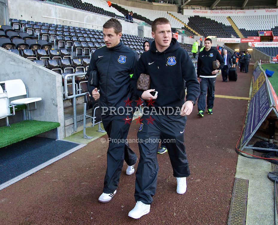 SWANSEA, WALES - Sunday, December 22, 2013: Everton's captain Phil Jagielka and James McCarthy arrive at the Liberty Stadium before the Premiership match against Swansea City. (Pic by David Rawcliffe/Propaganda)