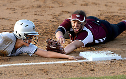 Bryan's Audriana Andrade (15), left, is called safe at third base as A&M Consolidated's (18) applies a tag as she yells to the umpire during the Lady Vikings win over the Tigers on Saturday.