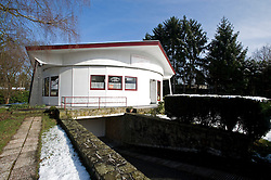 WAVRE, BELGIUM - MARCH-4-2008 - The Maison Tournante (turning house) is owned by Dominique Quinet, who has lived there since she was six years old. The house was built in 1958 and is still considered to be a remarkable example of environmentally friendly architecture. The house can rotate to follow or avoid the sun, greatly reducing heating and cooling costs. The small motors can turn the house full circle in 90 minutes.(Photo © Jock Fistick)