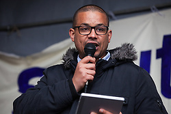 Southall, UK. 27th April 2019. Daniel Kebede, a NEC member of the National Education Union (NEU),  addresses members of the local community and supporters at a rally outside Southall Town Hall to honour the memories of Gurdip Singh Chaggar and Blair Peach on the 40th anniversary of their deaths. Gurdip Singh Chaggar, a young Asian boy, was the victim of a racially motivated attack whilst Blair Peach, a teacher, was killed by the Metropolitan Police's Special Patrol Group during a peaceful march against a National Front demonstration.