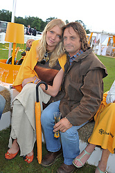 JODIE KIDD and ANDREA VIANINI at the 2012 Veuve Clicquot Gold Cup Final at Cowdray Park, Midhurst, West Sussex on 15th July 2012.