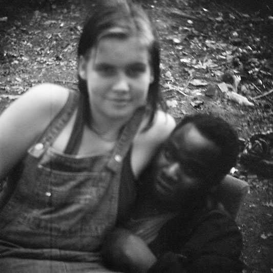 Young homeless couple Liza, Russian, and Sylva from Zambia. Moscow.