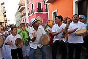 Musicians parade through the streets of Old San Juan during the Festival of San Sebastian in San Juan, Puerto Rico.