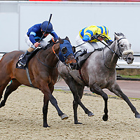 Electrician and Andrea Atzeni winning the 2.30 race