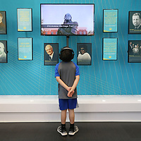 Van Boring, 8, listens to videos about Tupelo and Lee County history at the newly renovated Tupelo Convention and Vistors Bureau in Tupelo Thursday.