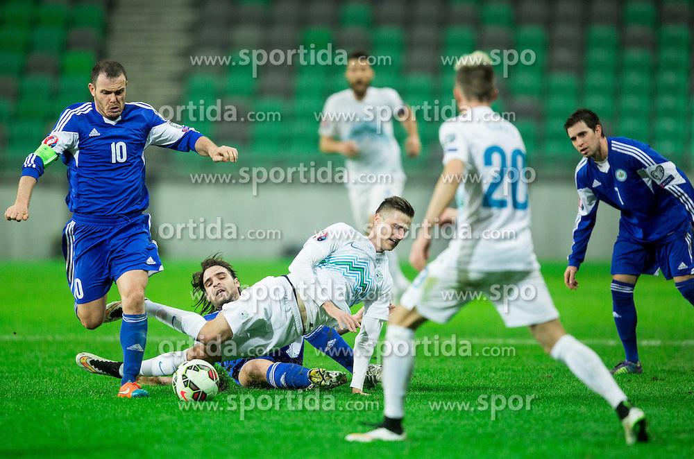 Andraz Struna of Slovenia faulted by Davide Simoncini of San Marino during football match between NationalTeams of Slovenia and San Marino in Round 5 of EURO 2016 Qualifications, on March 27, 2015 in SRC Stozice, Ljubljana, Slovenia. Photo by Vid Ponikvar / Sportida