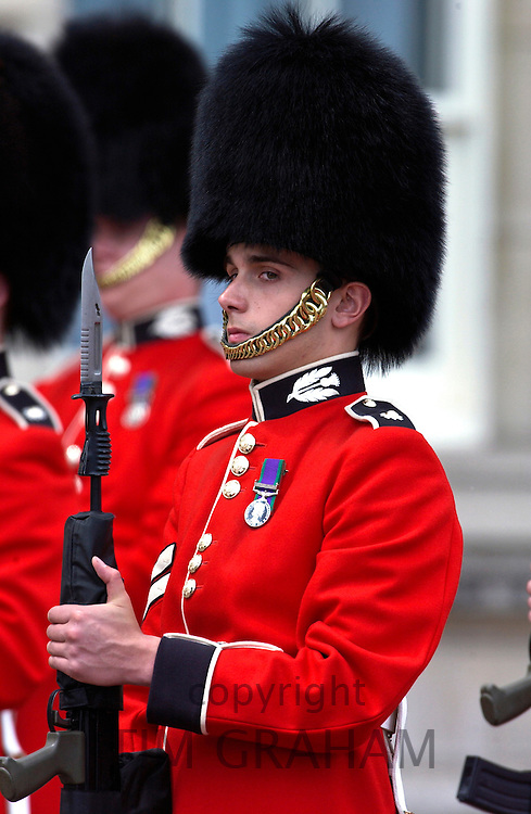 Scots Guard holding a rifle with bayonet