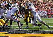 October 23 2010: Iowa Hawkeyes running back Adam Robinson (32) runs 1 yard for a touchdown during the first half of the NCAA football game between the Wisconsin Badgers and the Iowa Hawkeyes at Kinnick Stadium in Iowa City, Iowa on Saturday October 23, 2010. Wisconsin defeated Iowa 31-30.