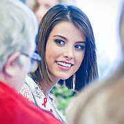 February 11, 2010 - Bronx, NY : Kristen Dalton, Stefania Fernandez (pictured) and Stormi Henley--Miss USA, Miss Universe and Miss Teen USA respectively--visited with residents at Schervier Nursing Care Center on Feb. 11.  Schervier resident Anna Kavanagh, 77, chats with Miss Universe Stefania Fernandez, left, on Feb. 11.