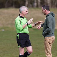 Match Referee Michael Rock warns Lifford Manager Tony McInerney to be quiet during the game