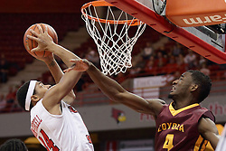 06 January 2016: Devon Turk(4) takes a swipe at the ball being taken to the basket by DeVaughn Akoon-Purcell(44) during the Illinois State Redbirds v Loyola-Chicago Ramblers at Redbird Arena in Normal Illinois (Photo by Alan Look)