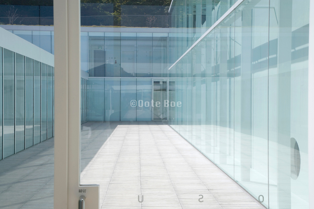 a modern glass museum building in Japan