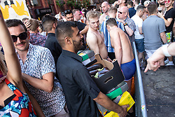 © Licensed to London News Pictures . 25/08/2019. Manchester, UK. A consignment of aubergines is delivered to a venue behind Canal Street . Revellers in Manchester's Gay Village during the city's annual Gay Pride festival , which celebrates LGBTQ+ life and is the largest of its type in Europe . Photo credit: Joel Goodman/LNP