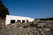 The post office remains gutted and submerged in debris in the Shizugawa district of Minami Sanriku, Japan on Tuesday 24 May 2011. Almost 100 post office buildings were completely destroyed during  the March 11 magnitude 9 quake and tsunamis that hit northeastern Japan.Photographer: Robert Gilhooly