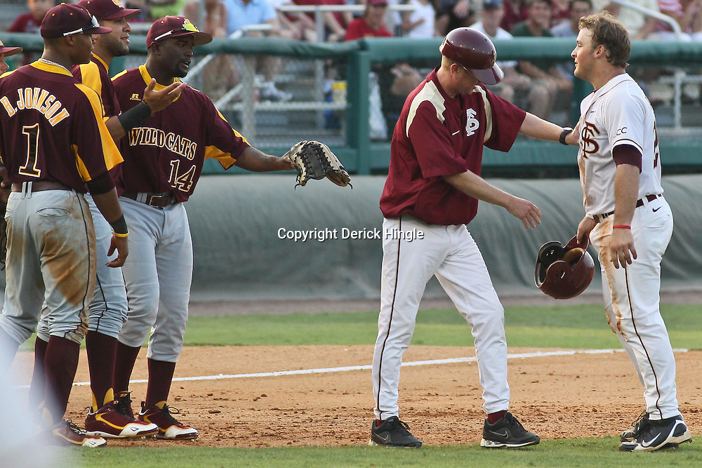 June 03, 2011; Tallahassee, FL, USA; Florida State left fielder Stuart Tapley (27) is held back after being tagged out at third base during the fifth inning of the Tallahassee regional of the 2011 NCAA baseball tournament against the Bethune-Cookman Wildcats at Dick Howser Stadium. Mandatory Credit: Derick E. Hingle