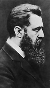 Theodor (Binyamin Ze'ev) Herzl (1860-1904) born in Budapest, Hungary, founder the Zionist political movement.  Head-and-shoulders profile photographic portrait.