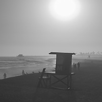 Lifeguard Tower M sunset black and white picture in Newport Beach, CA. Newport Beach is a popular coastal beach city in Orange County Southern California i n the Western United States of America. Photo is Copyright ⓒ 2017 Paul Velgos with All Rights Reserved.