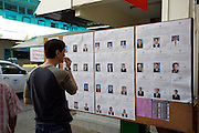 Bangkok/Thailand, parliamentary elections 2007. Bangrak District Office, optional pre-voting for registered citizens one week before the elections. Difficult choice between many candidates.