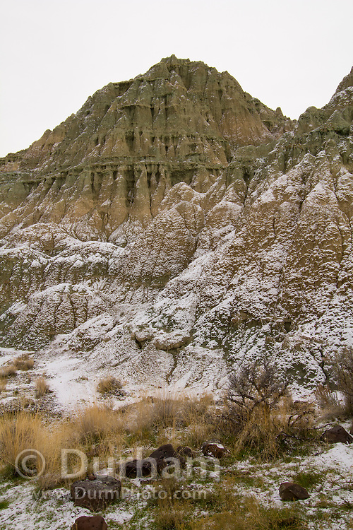 The Blue Basin feature of the John Day Fossil Beds National Monument; Oregon. Formed from 29-million-year-old volcanic tuff, The erosion scarred slopes of these hills are slowly yielding fossils of ancient animals and plants.