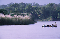 The only way of crossing Royal Chitwan National Park's Rapti River is by canoe.