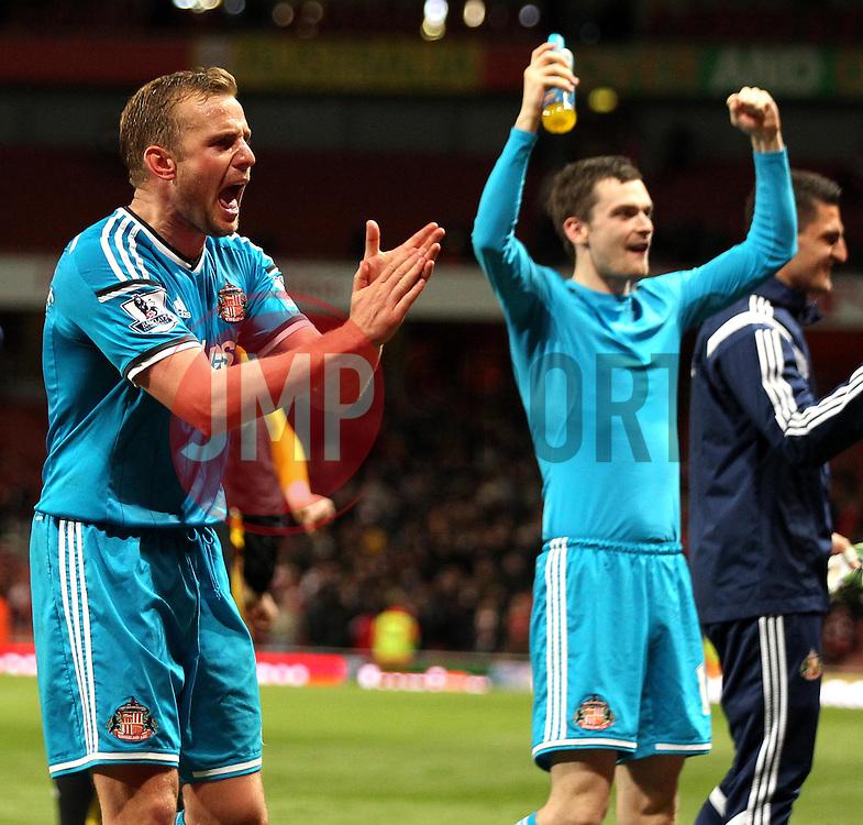 Sunderland's Sebastian Larsson and Sunderland's Adam Johnson celebrate - Photo mandatory by-line: Robbie Stephenson/JMP - Mobile: 07966 386802 - 20/05/2015 - SPORT - Football - London - Emirates Stadium - Arsenal v Sunderland - Barclays Premier League