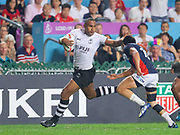 Fiji player Isake Katonibau fends off a Japanese defender  during Fiji v Japan  in the Cathay Pacific/HSBC Hong Kong 7s at Hong Kong Stadium, Hong Kong, Hong Kong on 7 April 2017. Photo by Ian  Muir.*** during *** v *** in the Cathay Pacific/HSBC Hong Kong 7s at Hong Kong Stadium, Hong Kong, Hong Kong on 7 April 2017. Photo by Ian  Muir.
