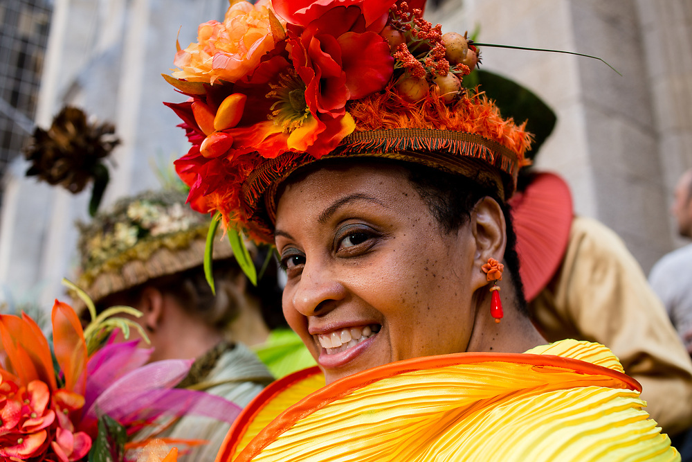 New York, NY - April 16, 2017. A woman in an elaborate hat designed by Jodie Trapani of The City Chicks at New York's annual Easter Bonnet Parade and Festival on Fifth Avenue.