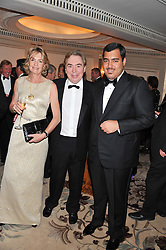 Left to right, LORD & LADY LLOYD WEBBER and SHEIKH FAHAD AL THANI at the 22nd Cartier Racing Awards held at The Dorchester, Park Lane, London on 13th November 2012.