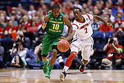 INDIANAPOLIS, IN - MARCH 29: Russ Smith #2 of the Louisville Cardinals tries to steal the ball from Johnathan Loyd #10 of the Oregon Ducks during the regional round of the 2013 NCAA Men's Basketball Tournament at Lucas Oil Stadium on March 29, 2013 in Indianapolis, Indiana. (Photo by Joe Robbins)
