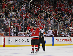Oct 15; Newark, NJ, USA; New Jersey Devils defenseman Matt Taormina (20) celebrates his first career NHL goal during the second period of their game against the Colorado Avalanche at the Prudential Center.