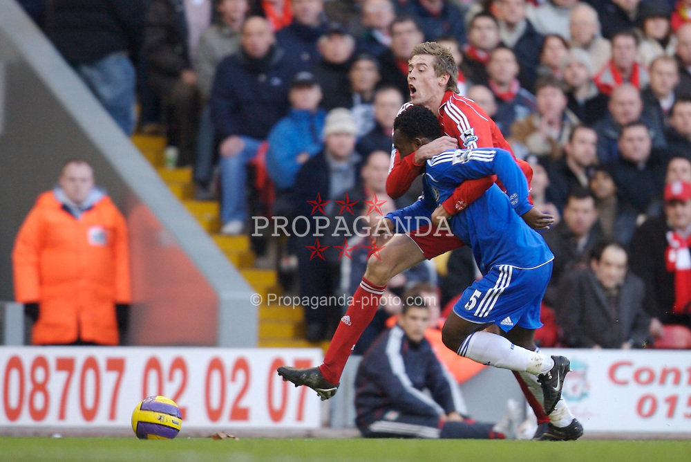 Liverpool, England - Saturday, January 20, 2007: Liverpool's Peter Crouch is fouled by Chelsea's Michael Essien during the Premier League match at Anfield. (Pic by David Rawcliffe/Propaganda)