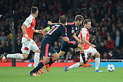 Arsenal defender Nacho Monreal plays the ball away from Bayern Munich striker Thomas Muller during the Champions League  Group F match between Arsenal and Bayern Munich at the Emirates Stadium, London, England on 20 October 2015. Photo by Alan Franklin.