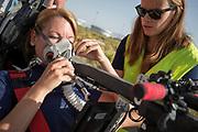 Aniek Rooderkerken zit klaar voor een testrun.In Battle Mountain, Nevada, oefent het team op een weggetje. Het Human Power Team Delft en Amsterdam, dat bestaat uit studenten van de TU Delft en de VU Amsterdam, is in Amerika om tijdens de World Human Powered Speed Challenge in Nevada een poging te doen het wereldrecord snelfietsen voor vrouwen te verbreken met de VeloX 7, een gestroomlijnde ligfiets. Het record is met 121,44 km/h sinds 2009 in handen van de Francaise Barbara Buatois. De Canadees Todd Reichert is de snelste man met 144,17 km/h sinds 2016.<br /> <br /> With the VeloX 7, a special recumbent bike, the Human Power Team Delft and Amsterdam, consisting of students of the TU Delft and the VU Amsterdam, wants to set a new woman's world record cycling in September at the World Human Powered Speed Challenge in Nevada. The current speed record is 121,44 km/h, set in 2009 by Barbara Buatois. The fastest man is Todd Reichert with 144,17 km/h.